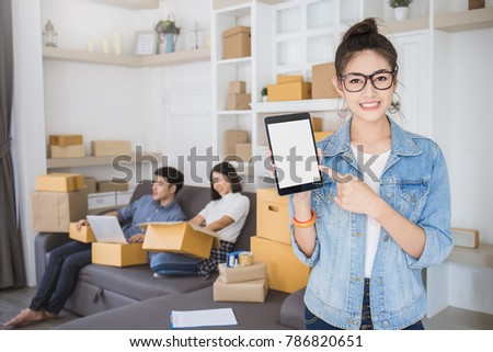 Startup small business entrepreneur SME freelance woman work at home office, Asian small business owner use smartphone, online marketing packing delivery, SME e-commerce telemarketing team concept