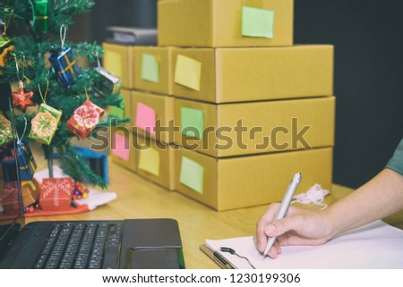 startup small business owner writing note. freelance man seller working at home.  Online selling, e-commerce concept