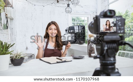 Startup successful small business owner sme beauty vlogger girl video online marketing camera in cafe. Portrait young asian woman barista cafe owner. SME entrepreneur blogger online business concept