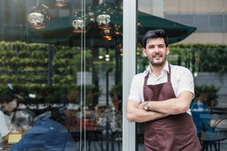 Startup successful sme small business owner man walking in his coffee shop or restaurant. Portrait of young smile caucasian man successful barista cafe local owner job with copy space