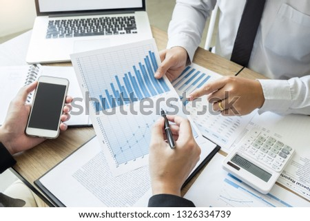 Startup Teamwork Brainstorming Meeting with Graph Planning strategy and financial plan to investment  #1326334739