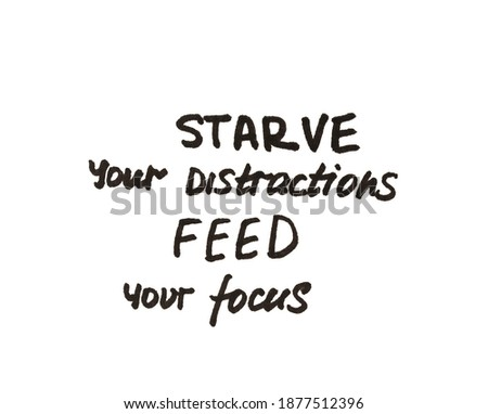 Starve your distractions feed your focus! Handwritten message on a white background. Stock photo ©
