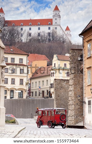 Stary Hrad - ancient castle and vintage car on old street in Bratislava, Slovakia