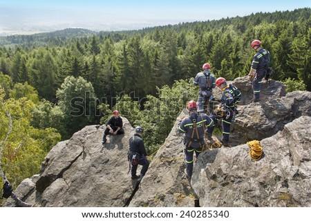 Stary Plzenec, Czech Republic, June 3, 2014: training rescue team. Rescue in rocky terrain near the castle RADYNE.