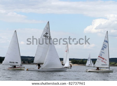 STARY SALTOV,UA - AUGUST 6: Class Finn sailing boats compete during Slobozhanshina Sailing Cup. August 6, 2011 in Stary Saltov, Ukraine