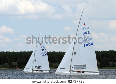 STARY SALTOV,UA - AUGUST 6: Class Star sailing boats unidentified participants compete during Slobozhanshina Sailing Cup. August 6, 2011 in Stary Saltov, Ukraine - stock photo
