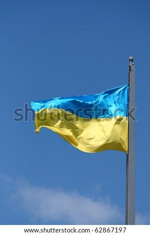 State flag of Ukraine against the blue sky - stock photo