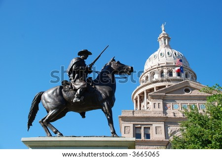 State of Texas Capitol building with a Texas Ranger guarding it at its feet