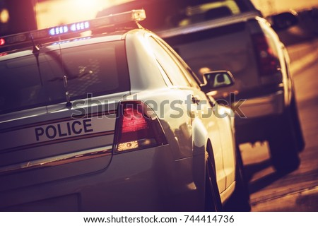 State Police Traffic Stop on a Highway. Police Cruiser with Flashing Lights.