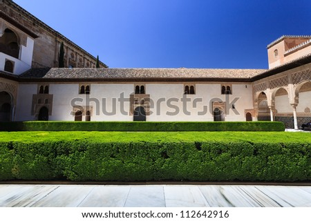 Stately, white, walls and arches in the courtyard garden