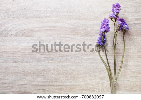 Static flowers on wood background.