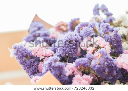 Statice flower bouquet, as a meaningful gift, mixed with purple, pink and white statice in soft focus. Copy space for adding text.