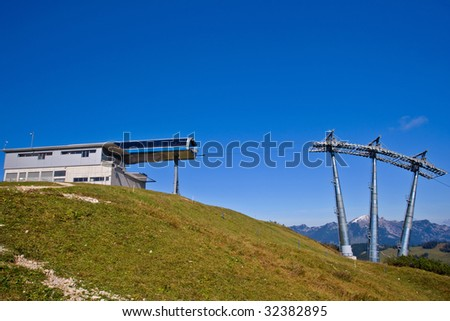Station and ski lift tower under high mountains, Gosau Austria