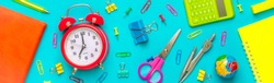 Stationary, back to school,summer time, creativity and education concept.Supplies- scissors, pencils, paper clips,note,stapler and notepad, globe on blue background,flatlay.Mock up.Top view Banner