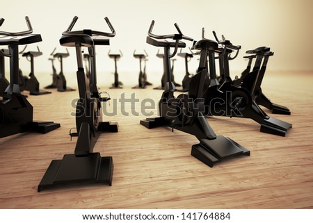 Stationary bicycle, exercycle is a device used as exercise gym equipment. They help increasing general fitness, are used in sports training or phisical therapy.