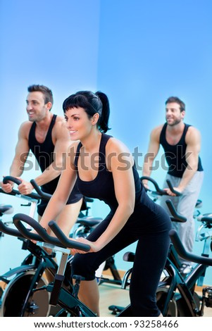 Stationary bicycles fitness girl in a gym sport club