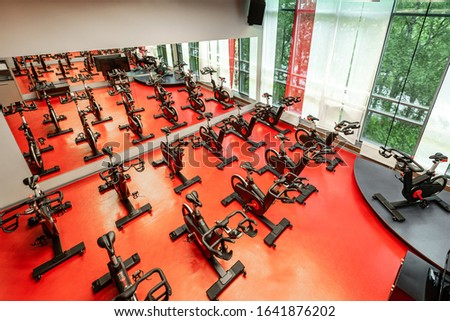 Stationary bicycles. Indoor cycling for lifestyle design. Fitness background. class with empty bikes. Soft focus background.