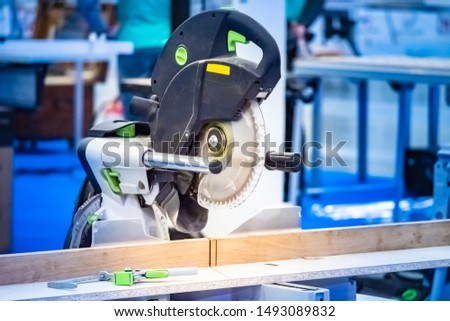 Stationary circular saw. Joiner's workshop. Circular saw cuts a tree. Professional carpentry tools. Lumber processing. Tool for decorating. circular saw at workplace. Wood cutting. Joinery biznes.