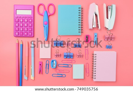 Stationary concept, Flat Lay top view Photo of school supplies scissors, pencils, paper clips,calculator,sticky note,stapler and notepad in pastel tone on pink background with copy space, flat lay.