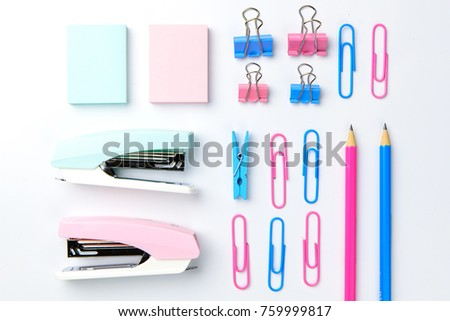 Stationary concept, Flat Lay top view Photo of Scissors, pencils, paper clips, sticky note,stapler in pink and blue tone on white background with copy space.