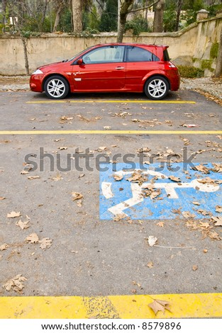 Stationary red car in autumn background