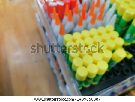 Stationery and miscellaneous consumer product on shelves in the convenience store, concept blurred background. #1489860887