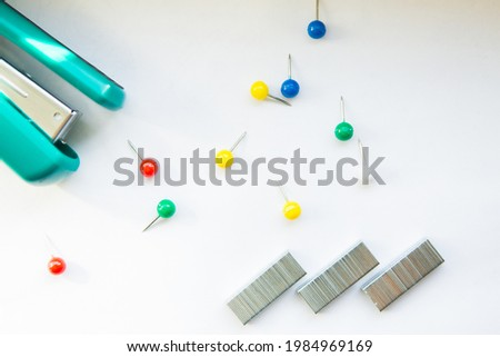 Stationery buttons, staples and stapler on white background Stockfoto ©