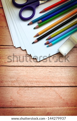 stationery for school/School and office supplies frame, on wooden background, back to school