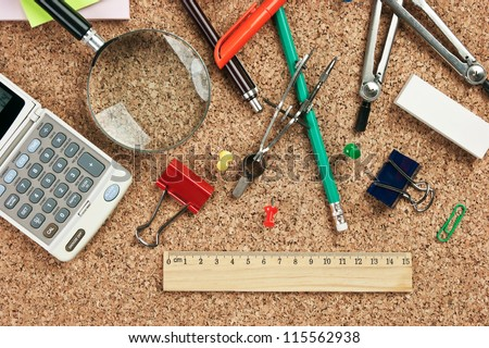 stationery in a mess on the table - stock photo