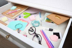 Stationery in open desk drawer closeup