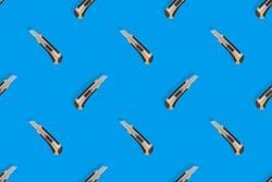 Stationery knives seamless pattern on a blue background.
