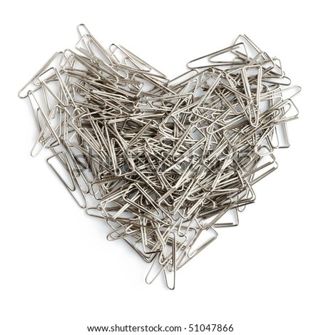 Stationery love concept. Heart shaped staples background.