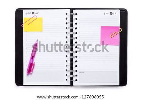 Stationery notebook with pink ballpen and adhesive paper