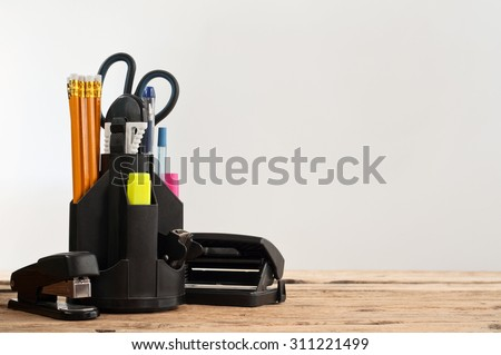 Stationery on wooden table on a gray background, closeup. Copy space. Free space for text stock photo