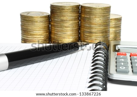 Stationery with stacks of coins