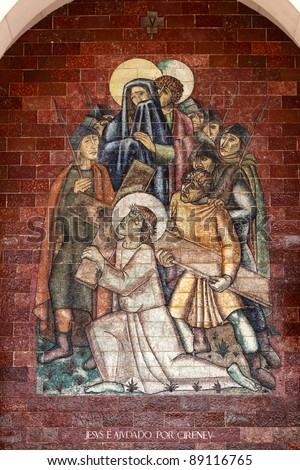 Stations of the Cross:Jesus is helped by Cireneu; A panel of Portuguese tiles outside the shrine of Fatima