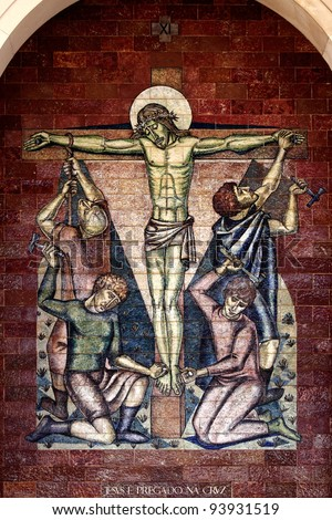 Stations of the Cross:Jesus is nailed to the cross; A panel of Portuguese tiles outside the shrine of Fatima