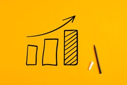 Statistical hand drawn financial graph predicting an economic financial growth or improvement on yellow background.