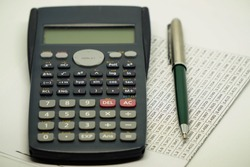 Statistics Z Table with Scientific Calculator and Pen on Isolated Background