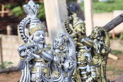 Statue art of Lord Krishna Playing Flute and Radha in Silver and Gold