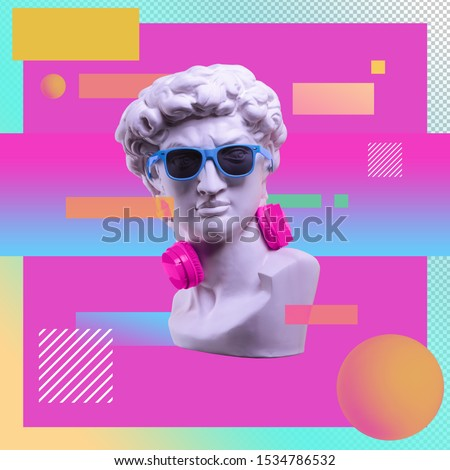 Statue. Earphone on a abstract background. Gypsum statue of David's head. Creative. Plaster statue of David's head in blue sunglasses. Minimal concept art.