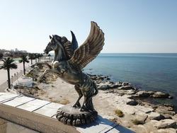 Statue flying horse pegasus a greek mythology figure on the roof of amphitheater in Aktau, Kazakhstan.