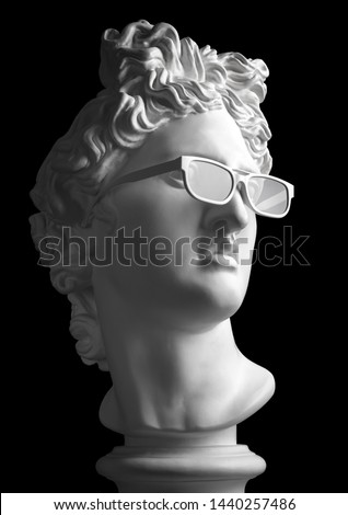 Statue. Gypsum statue of Apollo's head. Man. Creative. Plaster statue of Apollo's white sunglasses. David Apollo. Sculpture. Apollo Belvedere. Black Lives Matter