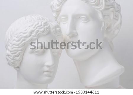 Statue. Gypsum statue of Venus head. Gypsum statue of Apollo's head and of Venus. Woman. Head. Portrait of beautiful Venus. Heavenly love. Love is beautiful always. Beautiful sculpture. Адам и Ева