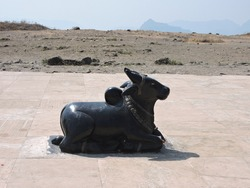 statue idiol or sculpture of nandi. nandi is lord Shiva's holy bull. in hinduism people worship him and pray him before lord mahadev. its always there outside of the mahadev lord Shiva's temple.