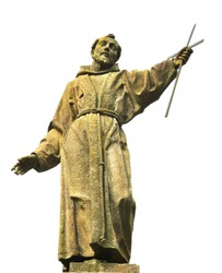 Statue in carved in stone of St Francis of Assisi  holding a cross into the sky isolated against a white background