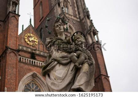 Statue in front of Katedra św. Jana Chrzciciela in Wrocław, Poland Zdjęcia stock ©