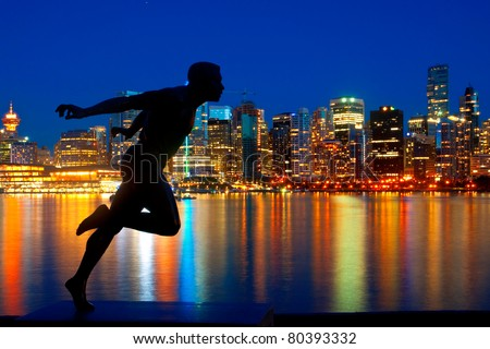 Statue in Stanley Park, Vancouver, British Columbia with a beautiful view of the city skyline behind.