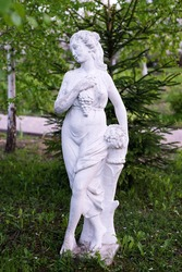 Statue in the garden, woman with grape