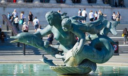 statue in Trafalgar square london dolphins with mother and children